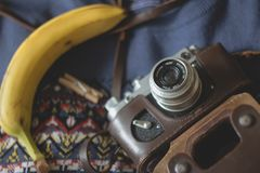 Vintage camera and banana Stock Images