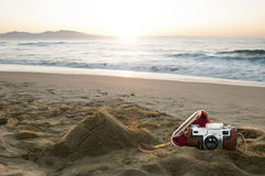 Vintage camera on the beach Royalty Free Stock Images