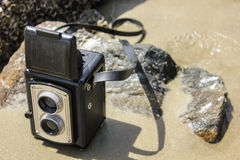Vintage camera on beach Royalty Free Stock Photo