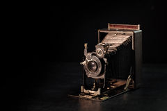 Vintage camera. On a black background Stock Photo