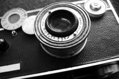 Vintage camera, black and white. Vintage rangefinder camera ca. 1939 shown in black and white in hard focus Royalty Free Stock Photography