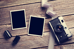 Vintage camera and blank photo frames Stock Images