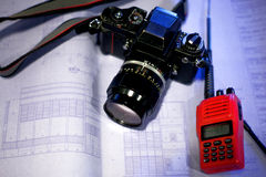 Film camera and radio communication on blueprint Royalty Free Stock Images