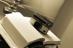 Vintage camera on book royalty free stock image