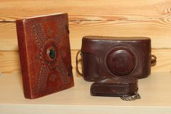 Vintage camera. In brown leather cover. Retro Royalty Free Stock Image