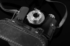 Vintage camera in the case on the mirror table stock photography