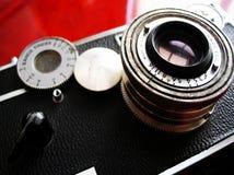 Vintage camera on cherry desk. Vintage rangefinder camera ca. 1939 on deep red cherry wood desk in soft or mood focus Stock Photography