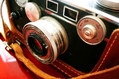 Vintage camera on cherry desk Royalty Free Stock Photo