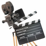 Vintage camera and clapperboard. Movie composition. Vintage camera and clapperboard. 3d Stock Photos