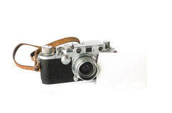 Vintage camera. A classic 35 mm camera from 1939 with a blank photo. Put your own photo on the blank paper Royalty Free Stock Image