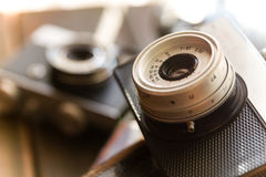 Vintage camera close-up. On wooden table Royalty Free Stock Image