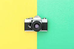 Vintage camera color background Retro style Minimalistic. Vintage camera on color background. Retro style toned picture. Minimalistic concept Royalty Free Stock Photos