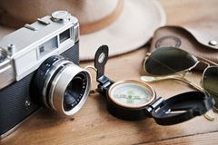 Vintage camera, compass, sunglasses and hat. Royalty Free Stock Images