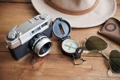 Vintage camera, compass, sunglasses and hat. Royalty Free Stock Photo