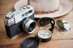Vintage camera, compass, sunglasses and hat. Royalty Free Stock Photos