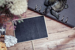Vintage camera, crumple paper,compas and planner book layout on wooden floor. Stock Images