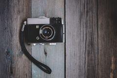 Vintage camera on dark wooden table royalty free stock photo