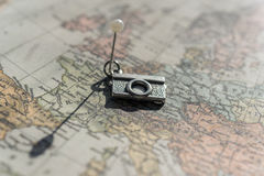 Vintage camera decoration pinned to antique map, long shadow. Travel concept royalty free stock image