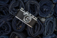 Vintage camera on denim background. Vintage rangfinder camera on denim background Stock Image