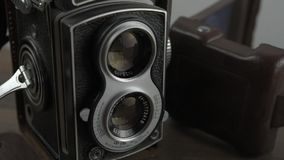 Vintage camera with dual lens. Twin lens reflex pan shot stock footage