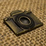 Vintage Camera Emblem. Made of brass on jute pencil Pouch royalty free stock image