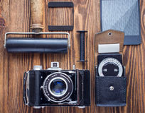 Vintage camera,exposure meter and another trappings of film photography. photographer`s desk. Stock Images
