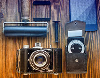 Vintage camera,exposure meter and another trappings of film photography. photographer`s desk. Stock Photo