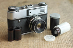 Vintage camera with film and case Stock Photography