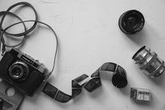 vintage camera, film, retro lenses on white table, copy space, black and white royalty free stock photos