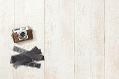 Vintage Camera And Film Strips On Floorboard Stock Image