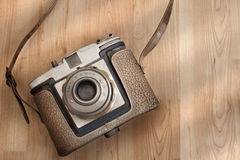 Vintage Camera on The floor. A vintage camera shot on the floor Royalty Free Stock Images