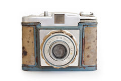 Vintage camera front side view. A vintage camera shot on white background Royalty Free Stock Photography