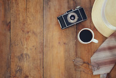 Vintage camera, glasses and fedora hat on wooden table Stock Photos