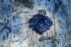 Vintage camera on a gray wooden background in the forest, the concept of wildlife,copy space. Close-up Royalty Free Stock Image
