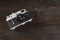 Vintage camera on a grungy wooden background stock photo