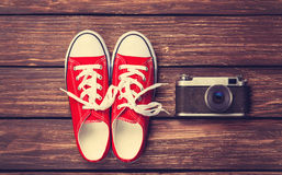 Vintage camera and gumshoes Royalty Free Stock Image