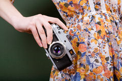 Vintage camera in hand stock images