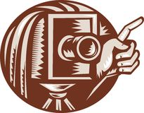 Vintage Camera Hand Pointing Retro. Illustration of a vintage bellow camera with hand pointing done in retro woodcut style set inside circle Stock Photos