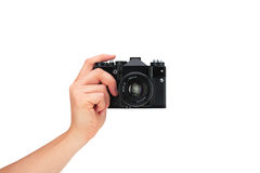 Vintage camera in hand on white background Royalty Free Stock Photos