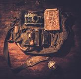 Vintage camera and handbag Stock Photos