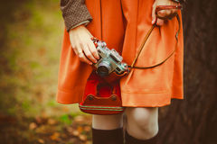 Vintage camera in the hands of the girl. Girl with Vintage camera in the hands Royalty Free Stock Image