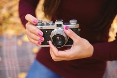 Vintage camera in the hands of a woman stock image