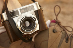Vintage camera with hiking boots on the ground. Travel Stock Photos