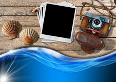 Vintage Camera with Instant Photos and Seashells Stock Photo