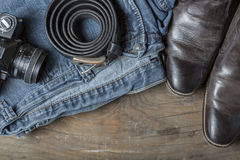 Vintage camera jeans and boots Royalty Free Stock Photos
