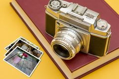 Vintage Camera with a landscape Photo frames royalty free stock photos