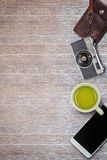 Vintage camera , leather bag ,smartphone and cup of tea Stock Image