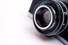 Vintage Camera Lens. Isolated on white background - shallow DOF Stock Images