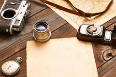 Vintage camera and lens on antique XIX century map Stock Photography