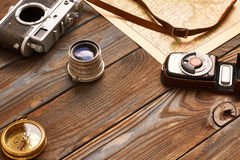 Vintage camera and lens on antique XIX century map Royalty Free Stock Photos